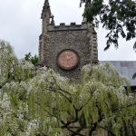 St Michael at Plea with white wisteria